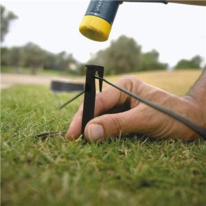 Hammering Guidewires into lawn